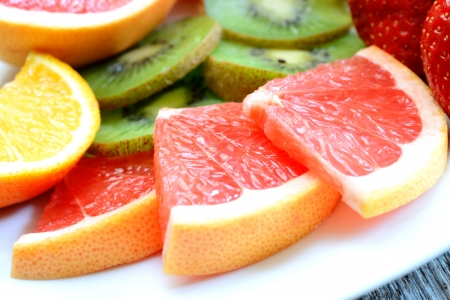 vaus fresh colored  fruit on wooden table Stock Photo - 20174489