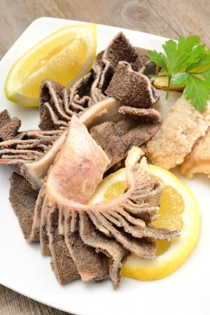entrails of stomach of beef cooked in salted water with lemon juice called trippa tripe Stock Photo - 20355232