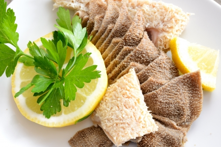 entrails of stomach of beef cooked in salted water with lemon juice called trippa tripe Stock Photo - 20355273
