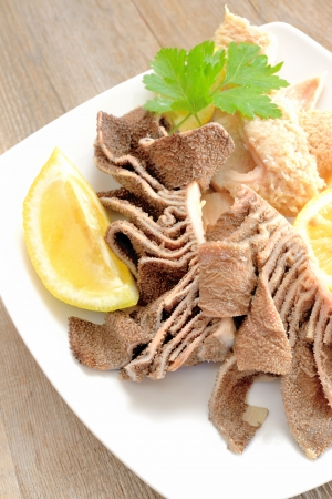 parsley digestion: entrails of stomach of beef cooked in salted water with lemon juice called trippa tripe