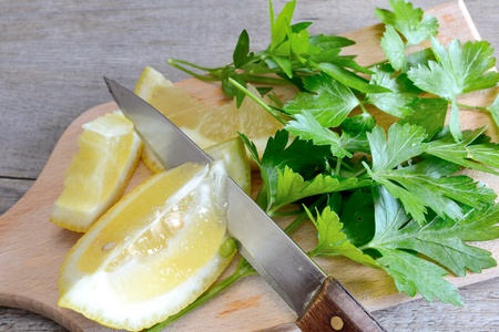 lemon and chopped parsley on wooden cutting board natural Stock Photo - 20448012