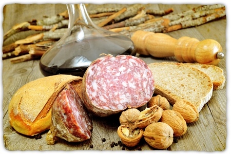 brawn: table with genuine products of Italian salami nuts and whole wheat bread Stock Photo