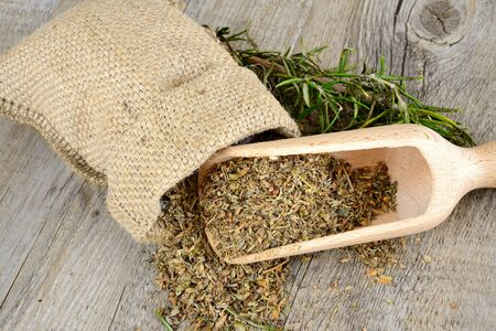 herbs and fragrant on wooden table in a jute bag