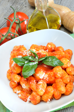 gnocchi flour dumplings with tomato sauce, basil and mozzarella