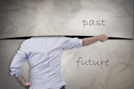 concept of man cutting with the past but is afraid of the future photo