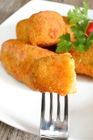breadcrumbs: typical neapolitan food  potato croquettes fried made ​​with mozzarella cheese and diced bacon