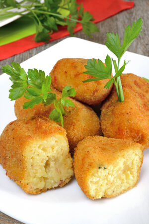 zeppole: typical neapolitan food  potato croquettes fried made ​​with mozzarella cheese and diced bacon Stock Photo