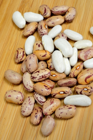 borlotti beans: dried white and red beans on cutting board