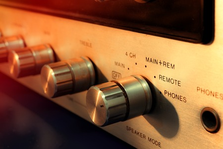 aged audio tools and equipment such as headphones and turntable
