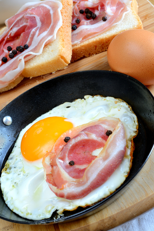 fired egg: fired egg with bacon and toated bread