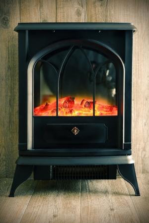 retro model of fireplace on wood background