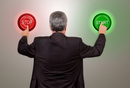 concept businessman undecided to push art or stop button