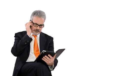 careerist: businessman at work with tablet on white background