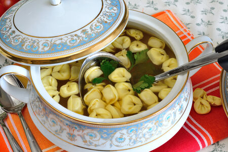 chese: bowl with hot beef broth and italian  tortellini