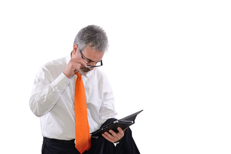 myopia: mature business man who has difficulty reading on tablet Stock Photo