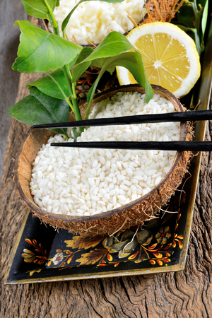 emptied: Chinese polished white raw rice in coconut emptied