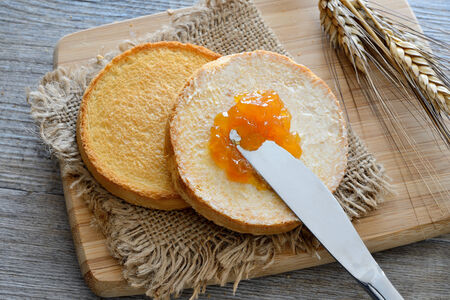 Breakfast with dutch golden crunchy rusks and apricot jam
