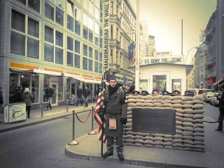 checkpoint: BERLIN,GERMANY- Circa 2012: The definition of Checkpoint Charlie emerged from the NATO phonetic August 13, 2000 it was opened a faithful reconstruction, in a short time become a great tourist attraction. on18,2012 in Berlin-Germany