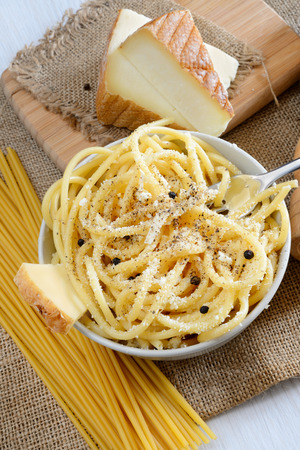 italian pasta bucatini with pecorino cheese and black pepper