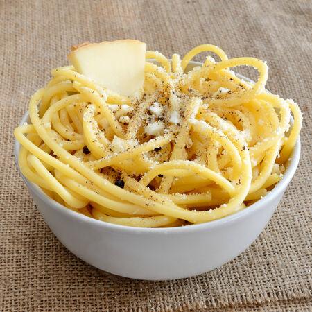 italian pasta bucatini with pecorino cheese and black pepper