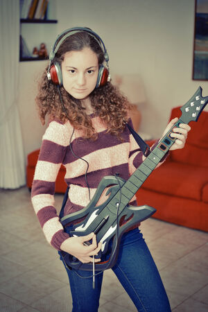 young blonde girl plays with her electric guitar stock photo