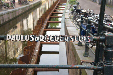 paulus: AMSTERDAM, AUGUST 4:The Bridges of Amsterdam all have a number. The 215 is in the red light district and is named Paulus monaco that lived in this area the medieval period on August 4, 2014 in Amsterdam