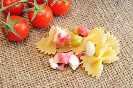 talian: talian type pasta called farfalle butterflies and little tomatoes
