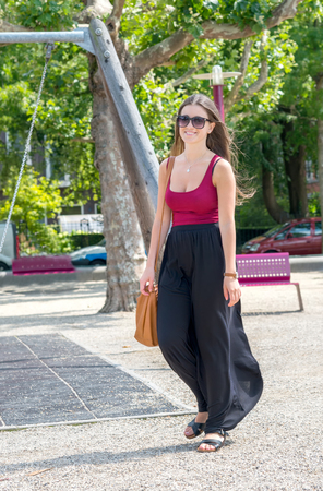 long skirt: brunette woman with long skirt and sunglasses