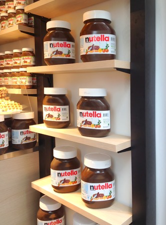 nutella: AMSTERDAM, CIRCA AUGUST 2014: Store of Nutella exposes the famous 5kg jar giant made by the Italian company Ferrero in Amsterdam circa  august 2014 in Amsterdam Editorial