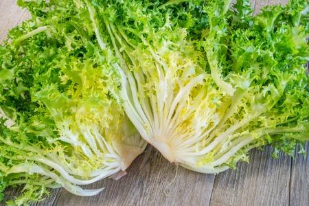 escarole: curly rotating salad on white background Stock Photo