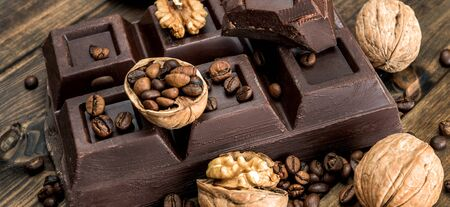 chocolate and walnuts on old wood background