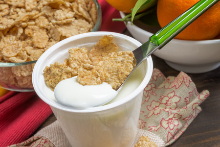 lowfat: low-fat plain yogurt creamy with crispy cereals Stock Photo