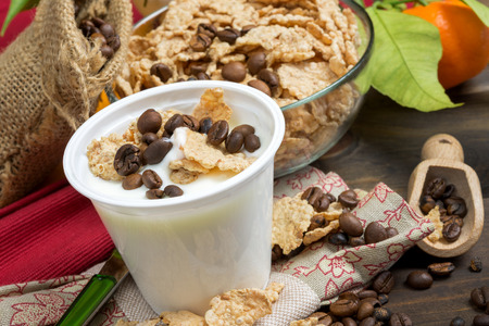 lowfat: low-fat plain yogurt creamy with crispy cereals and coffee beans Stock Photo