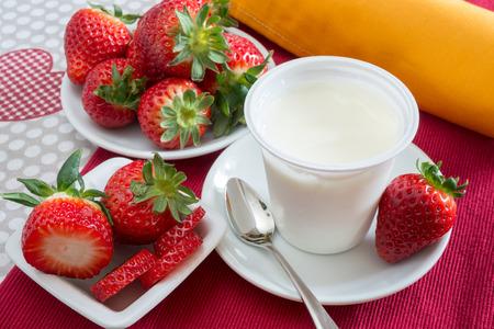 lowfat: low-fat plain yogurt creamy strawberry flavor Stock Photo