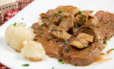 veal: scallops of veal with porcini mushroom sauce and parsley