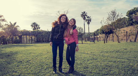 footing: young girls smiling  in the park Stock Photo