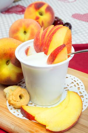 lowfat: low-fat plain yogurt creamy peaches flavor