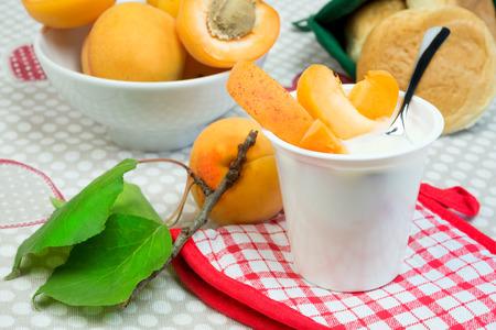 lowfat: low-fat plain yogurt creamy apricots flavor Stock Photo