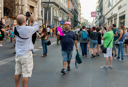 homophobia: NAPLES, ITALY- JULY 11:Some participants in the Gay Pride every year brings together thousands of gay people and not to claim the rights to sexual freedom and against homophobia on  july 11, 2015 in Naples