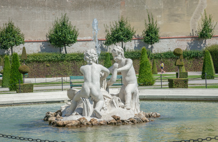 princely: WIEN - AUGUST 1: details of fountain statues of Belvedere Castle since 1712 is a masterpiece of Baroque Austrian and one of Europes most beautiful princely residences on august 1, 2015 in Wien