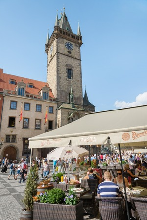 4 people: PRAGUE - AUGUST 4: people  in old town hall or clock tower and The Tyn Church on  background on august 4,2015 in Prague - Czech
