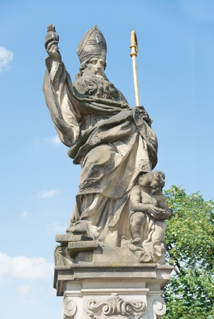 st charles: Statue of St. Augustine dIppona of 1708 on Charles Bridge - Prague