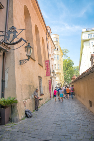 owes: PRAGUE, AUGUST 6:view  of the Golden Lane, famous street in Prague, located in the castle.The street owes its name to the goldsmiths who inhabited it on august 6, 2015 in Prague - Czech Republic