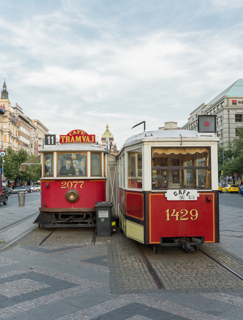 transformed: PRAGUE, AUGUST 6:Antique tram no longer circulating in St. Wenceslas Square, transformed into bars on august 6,2015 in Prague - Czech Republic