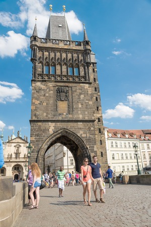 praga: PRAGUE - AUGUST 5: People walking on the famous Charles Bridge, completed in 1400 and is 515 meters long  on august 5,2015 in Prague - Czech Republic