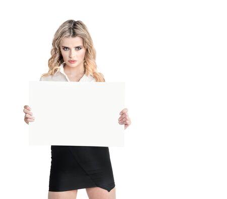 miniskirt: beautiful blonde woman in miniskirt posing on white background with blank sheet Stock Photo