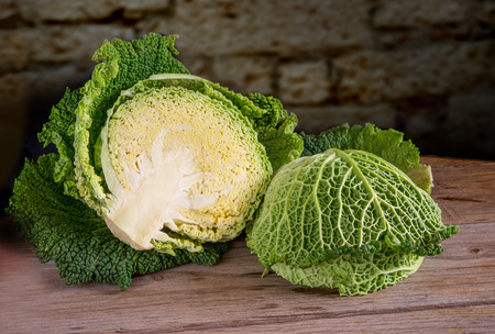 savoy: fresh sliced savoy cabbage on wooden table