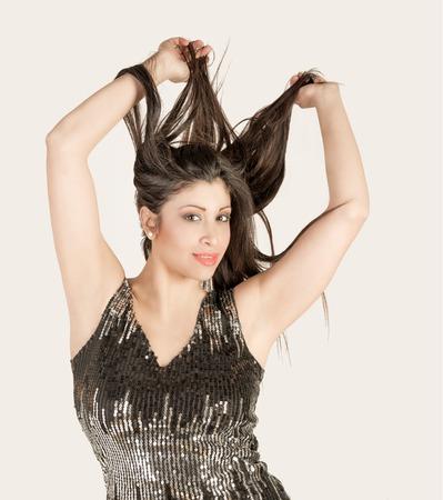 beautiful nice brunette woman posing on white background