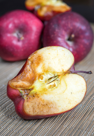 stinks: apple sliced with mold on the rustic table Stock Photo