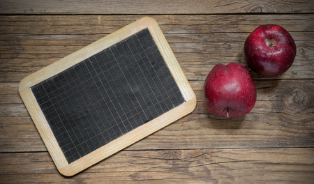 apple sack: fresh delicious red apples on wood with blackboard Stock Photo